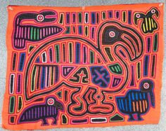 The Stork Delivering Baby and Mother Mola is truly a masterpiece...older collectable molas are very rarely found in this pristine condition. This mola was made in the 1960s...and is a perfect example of the Cuna art at its very height. The remarkable design is very skillfully executed. Take a close look at the tiny stitches, the complexity of the pattern and the fact that every square inch of the panel is decorated! This degree of skill, design, and condition is not often found in the more…