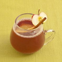 Warm Spiced Sangria | This spice-infused wine punch will fill you with warmth and cheer from the inside out. Serve in a clear glass mug to show off cinnamon stick and fruit garnishes. | SouthernLiving.com