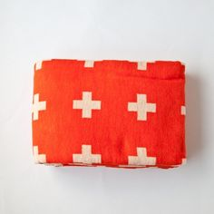 I'm nuts about Swiss Cross and Red Cross design/emblems... Pia Wallen blanket - via Oh Joy!