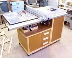 Mobile table saw and router cabinet - article about it and plans can be found at : http://www.binkyswoodworking.com/TblSawCab.php