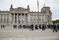 Preparations for the group photo in front of the German Bundestag.