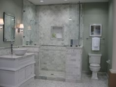 Hampton Carrara, Biltmore Niles, Bilmore #frameless shower #thetileshop #marble Love the scones and frameless shower