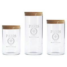 Perfect for stowing pantry ingredients or office supplies, these glass canisters showcase cork lids and Parisian-inspired labels.   ...