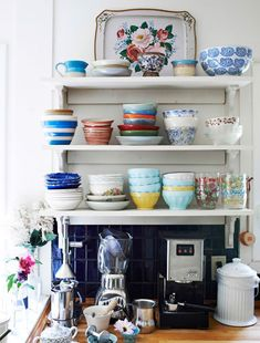 Open up storage for display 'We kept the basic layout of the old kitchen but fitted open shelves instead of wall cabinets to give the room a sense of openness – and so that I can display my crockery.'  Click to find out more about Tamar's home.