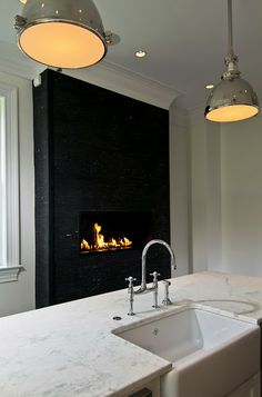 Haute Indoor Couture: Kitchens love the wall mounted fireplace