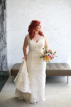 Scalloped ivory and gold lace Moonlight bridal gown H1199. Pink, peach and white bohemian bouquet.