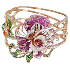 Blue River Bangle with crystal, brown diamonds, white diamonds, orange sapphire, pink sapphire and tsavorite