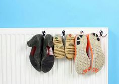 Use space on radiator for hanging shoes.