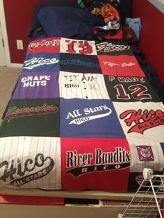 T-Shirt Quilt...what a special thing to do with all of those old jerseys from your kids' sports teams!!