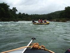 A distant view of rafting on the Mhadei River. #Goa