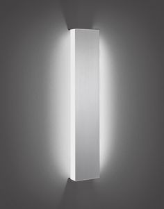 Illusion Sconce - OCL Architectural Lighting - possilble option for bathroom vanity lighting?  Mounted above the mirror would give flattering light, as well as on either side of the mirror.  A more contemporary option, but could work well with traditional elements as well.
