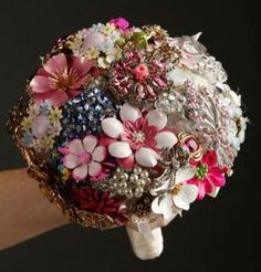 I'm not much for DIY but I Love this idea- Brooch Bouquet