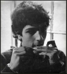 Syd Barrett from Pink Floyd preparing a cigarette !!