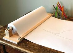 If you've ever used large paper rolls, either for your own art/design use or because you are around kids, you know that they can be a little annoying to use. This tabletop wooden paper cutter holds...