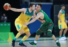 Matthew Dellavedova of Australia handles the ball against Adas Juskevicius of Lithuania during the men's basketball quarterfinals in the Rio 2016 Summer Olympic Games at Carioca Arena 1.