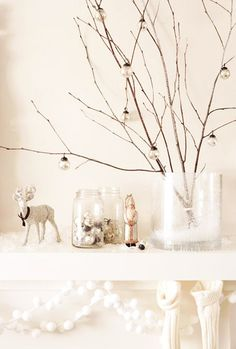 After christmas I like to keep it simple for the winter months - this branch arrangement would look cute in my bay window with my lamb collection underneath.