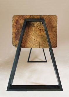 pirsqur:    Dovetail shaped blackened steel legs nested into a reclaimed beam.