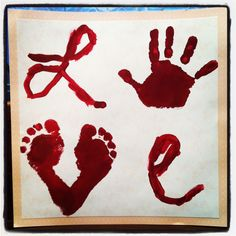 "Foot and Hand Print LOVE Painting--I used this idea for Mother's Day.  I put the painting on the wrong side of the glass in a shadowbox frame with scrapbook paper inside, and then I used an ""O"" instead of the handprint--I put Buddy's picture behind the ""O"" instead.  So cute.  Now I want one for myself."