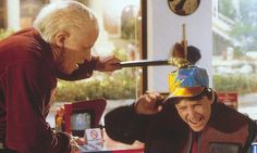 """Old Biff hits Marty with his cane. """"Hello, McFly!"""""""