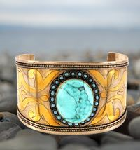 """Turquois Cuff Bracelet ~ Inlaid with turquoise stones that evoke the divine beauty of the heavens. Handmade in the ancient tradition of Afghanistan's legendary jewelry artisans.    •Silver, brass, & turquoise    •1.75"""" W x 2.5"""" diameter (4.4 x 6.4 cm); will bend to fit most wrists  •Handmade in and fairly traded from Afghanistan"""