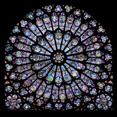 The classic, magnificent beauty of the North Rose of Notre Dame in Paris, France. It is one of the most famous stained glass windows in the world.      #windows #notredame #paris #classic #beauty #windowsanddoors #stainedglass #rose