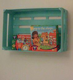 fruit boxes painted in aqua blue as book shelves #DIY