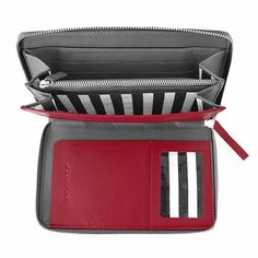 Slots, slits, pouches, pockets -- who wouldn't stay organized with this? Marimekko Tapani Red/Grey Leather Travel Case - $190