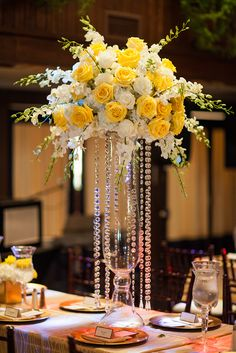 Are you thinking about having your wedding by the beach? Are you wondering the best beach wedding flowers to celebrate your union? Here are some of the best ideas for beach wedding flowers you should consider. Yellow Centerpieces, Tall Wedding Centerpieces, Wedding Flower Arrangements, Floral Arrangements, Wedding Bouquets, Wedding Decorations, Table Decorations, Tall Centerpiece, Centerpiece Ideas