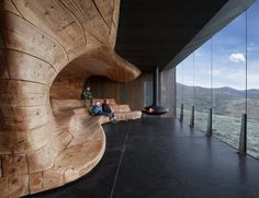 The simple form and use of natural materials reference local building traditions. advanced technologies have been utilized both in the design and the fabrication process. Using 3D computer models to drive the milling machines, Norwegian shipbuilders in Hardangerfjord have created the organic forms from 10 inch square pine beams.