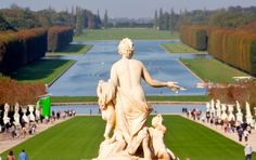 Touring the gardens of Versailles.