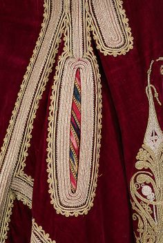 Coat Date: 1900–1909 Culture: Albanian Medium: silk, cotton, metal Dimensions: Length at CB: 46 1/2 in. The lavish use of materials and embellishment on this Albanian coat is both masterful and informative. The skillful embroidery depicts motifs and patterning that illustrate the cross-cultural influences in the region.