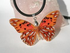 Dark Orange Butterfly Polymer Clay Necklace by cushyadornments