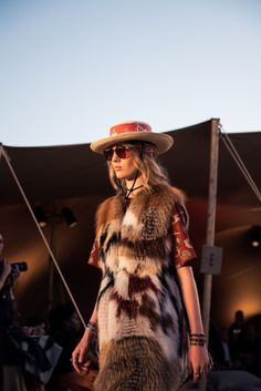 Inside Christian Dior's Cruise 2018 Los Angeles Show: The mountains of Malibu were the chosen backdrop for Maria Grazia Chiuri's first cruise show for the house. Fringe, ponchos, and flat top hats stole the show. -- Fur style     coveteur.com