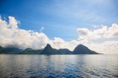 Mountainous coast of the island of Saint Lucia as seen from out at sea Saint Lucia, Saints, Coast, Stock Photos, Sea, Island, Spaces, Mountains, Photography