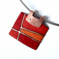 Pendant, enameled in red and orange.