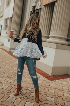 Cute maternity outfit with peplum sweater, distressed jeans, and ankle booties #maternityoutfit #datenightoutfit #bumpstyle #bumpfashion