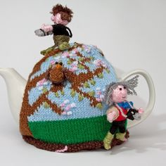 Spring watch tea cosy - knitted but so cute. Why not make one similar in crochet