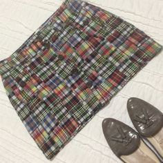 J. Crew Madras Skirt Cute and colorful madras style skirt by J. Crew goes with nearly every color and looks great on. Buttons up the front and at pockets. Length is almost a mini. J. Crew Skirts Mini
