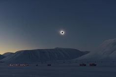 The eclipse cuts a starkly beautiful silhouette against of the Arctic landscape of Svalbard. -  Credit: Dr. Miloslav Druckmüller