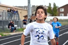 """Augustin Rivera, fourth-grader at Ridgeview Elementary School, sprints at the District 49 field day. """"To be our here racing with my friends is amazing,"""" said Rivera, """"it's really fun to see how all of these schools come out here and train so hard."""" Fourth and fifth grade students from elementary schools across the district participated in multiple track and field events Thursday, May 14. The annual competition, in its 13th year, brought nearly 450 students together at Sand Creek High School."""