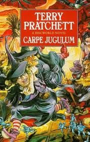 "Carpe Jugulum (Latatian for ""seize the throat"", cf. Carpe diem) is a comic fantasy novel by Terry Pratchett, the twenty-third in the Discworld series. It was first published in 1998. In Carpe Jugulum, Terry Pratchett pastiches the traditions of vampire literature, playing with the mythic archetypes and featuring a tongue-in-cheek reversal of 'vampyre' subculture with young vampires who wear bright clothes, drink wine, and stay up until noon."
