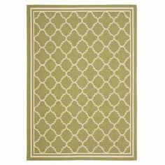 """Anchor your patio seating group or entryway decor with this lovely indoor/outdoor rug, showcasing a quatrefoil trellis motif in green and beige.  Product: RugConstruction Material: PolypropyleneColor: Green and beigeFeatures:  Quatrefoil trellis motifSuitable for indoor and outdoor usePower-loomed Made in TurkeyPile Height: 0.25""""Note: Please be aware that actual colors may vary from those shown on your screen. Accent rugs may also not show the entire pattern that the corresponding area rugs…"""