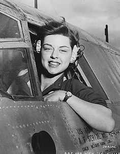 """WASP pilot Elizabeth L. Gardner at the window of her B-26 Marauder."""