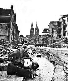 A German woman takes a break from her search for a new home after the war, 1945.