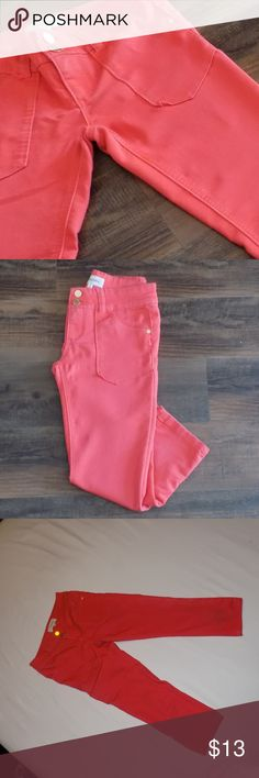 Coral color capri pants Coral Capri pants.  Juniors size 1.  There is a little wear around the knee area, but hardly noticeable.  I tried to get a picture, but my camera wouldn't even catch it. Fun spring and summer color is refreshing. Rewind Pants Skinny