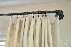 diy curtain rod - great idea for a long expanse that needs more support.