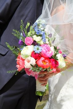 The Bridal Bouquet looked blissful in the Summer sunshine, the vibrant shades of the Coral peonies looked so magnificent with the blue Delphiniums and Purple Veronica Blue Delphinium, Delphiniums, Facebook Flower, Wedding Colors, Wedding Flowers, Flower Designs, Flower Ideas, Coral Peonies, Navy Weddings