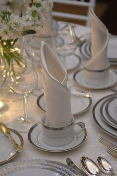 Classic silver and white. Love how the linen napkin is folded and displayed.