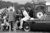 June 16, 1987:  Princess Diana had taken off her Ascot hat and rested on the bonnet of her husband's Aston Martin car at a polo match at Smith's Lawn, Windsor.  Prince Charles inspected the bodywork.