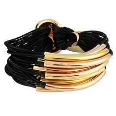 Gillian Julius Multi Tube Bracelet, Light Rose Gold & Gold   Black Cord. Multi strand bracelet consisting of 20 waxed cotton cords. Each cord of bracelet features either a rose or yellow gold tube. $275